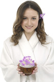 Close up portrait of young woman holding bowel of flower poster