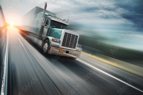 American truck speeding on freeway. Blurred motion.