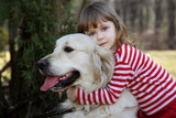 friends - little girl with big retriever outdoor