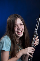 Teenage Girl Clarinet Player on Blue