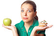 Young pretty woman. Dilema. Apple or cake. Health or tasty.