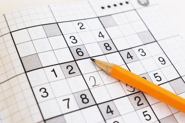close up of sudoku game and yellow pencil