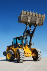 wheel loader bulldozer with rised bucket (focus on bucket)
