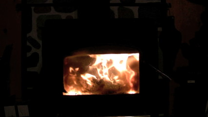 footage of flames inside woodburning stove