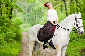 Cheerful girl riding horse
