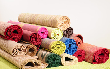 Rolled up carpets.
