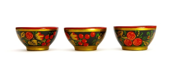 Three painted Russian khokhloma wooden cups isolated