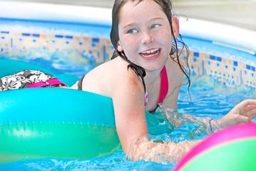 Happy girl in pool