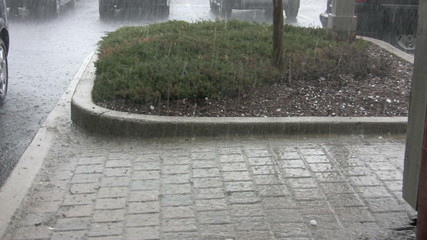 footage of hail storm on walkway