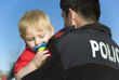 canvas print picture - Police Officer Holds baby