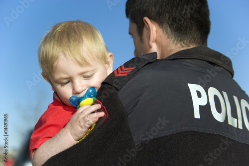 canvas print picture Police Officer Holds baby
