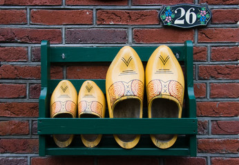 Storage rack with clogs next to frontdoor