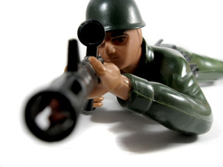 Toy soldier looks through the sight