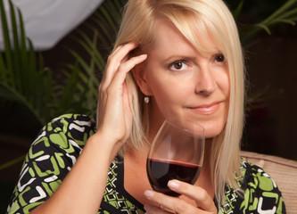 Beautiful Blonde Woman Enjoying Wine