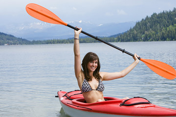 Happy woman on a kayak