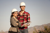 Man and woman in hardhats poster