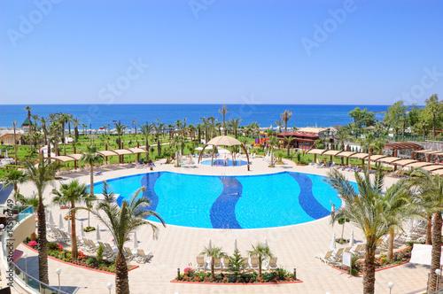 Leinwanddruck Bild Swimming pool area in popular hotel, Antalya, Turkey