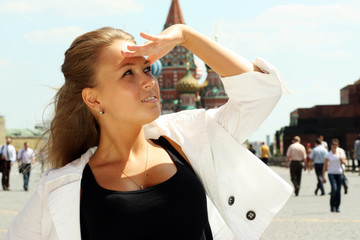 Portrait of the Russian girl on a background of sights of Moscow