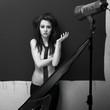 Pretty woman pose in photo-studio