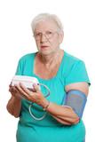 Senior woman use automatic blood pressure machine poster