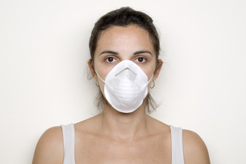 Latin Girl wit a mask against swine flu