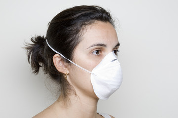 Girl with a mask against swine flu