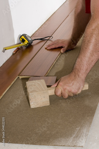 worker install a hardwood floor