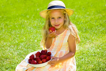 child with strawberries