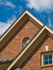 Luxury Model Home Exterior pitch roof window vertical