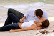 beautiful young wet couple kissing on beach