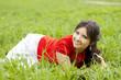 Beautiful girl lying on the grass