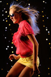 Young woman dancing in the nightclub poster