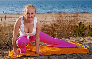 Beautiful girl doing exercise on the beach