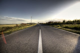 Country Asphalt road in strong flare poster