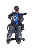 Businesman driving an office chair poster