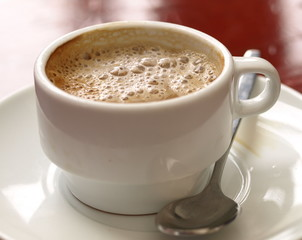 Coffe with milk in white cup - Spanish cortado.