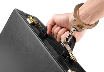 Hand on handcuffs with a briefcase