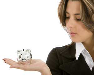 woman looking at a piggy bank