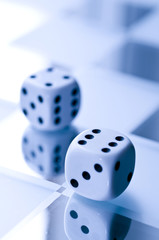 Dice on mirrored surface