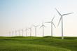 wind turbines on green grass field