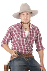 young cowboy with drawn pistol