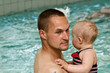 Father with daughter in swimming pool