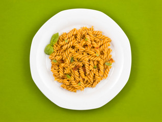 Italian pasta with tomato sauce and basil.