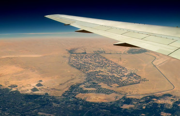 Aiplane above pyramids