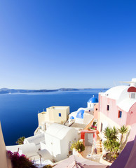 santorini greek island scene blue dome churches aegean sea