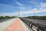 Modern bicycle lane on a suspension bridge.Europe. - 14622105