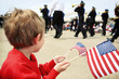 Young boy watching the memorial day parade