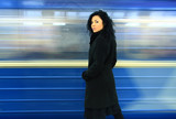 beautiful brunette against passing by an electro-train in underg poster