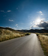 asphalt of country road in backlit
