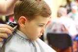 Fototapety Boy cut in hairdresser's machine